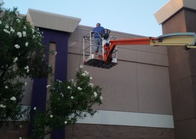 Man power washing exterior building, Dakota Power Washing, Phoenix, AZ